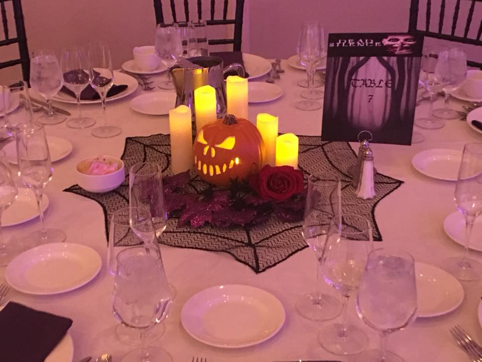 Jack-o-lantern centerpieces with horror movies table names